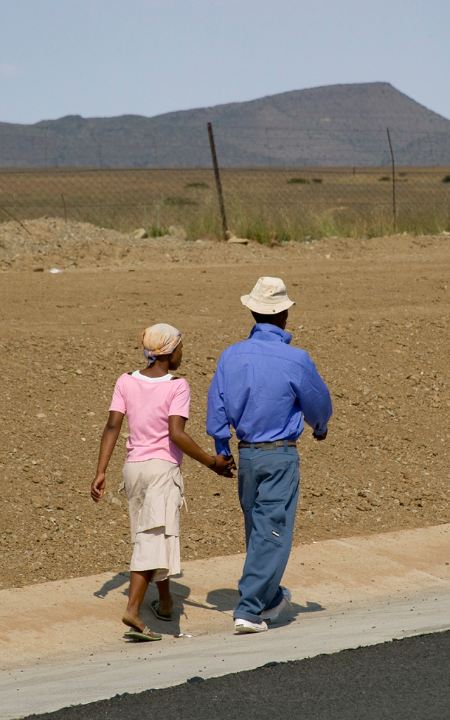 a smart young couple stepping out for a date in the barren Karoo